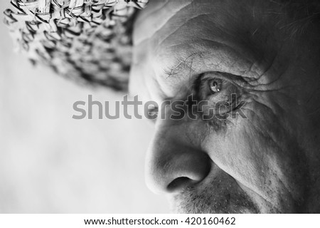 Portrait of an elderly man, part of the face.