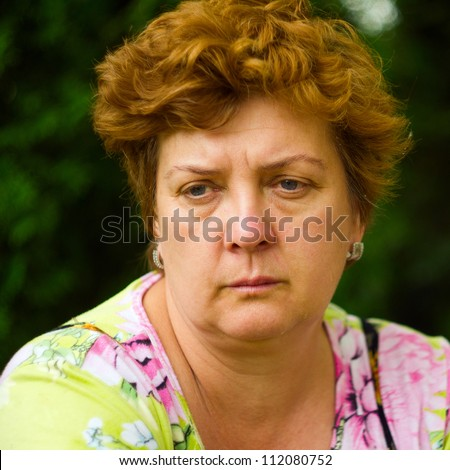 Portrait of an elderly woman deep in thought - stock photo