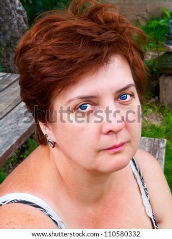Portrait of an elderly woman outdoors - stock photo