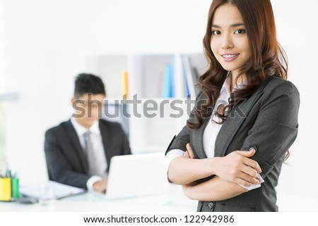 Portrait of an elegant business girl in office - stock photo