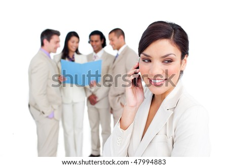 Portrait of an elegant businesswoman on phone with her team on the background - stock photo