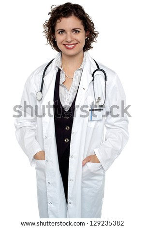 Portrait of an elegant medical practitioner posing casually against white background.
