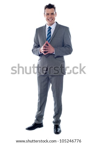 Portrait of an elegant young businessman isolated against white background - stock photo