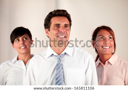 Portrait of an employee team smiling and looking at people while standing - copyspace