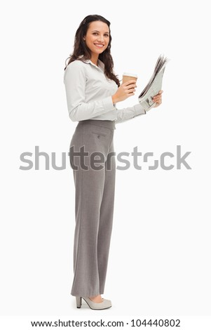 Portrait of an employee with a newspaper and a coffee against white background