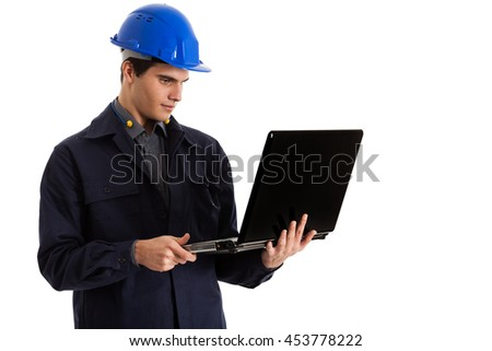 Portrait of an engineer using a laptop computer - stock photo