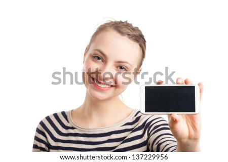 Portrait of an European blond woman in her twenties, showing a smart phone. Focus on the phone, woman blurred in the back. Isolated on white background. - stock photo