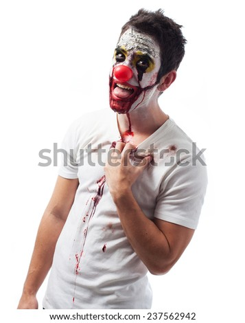 Portrait of an evil clown over white background - stock photo