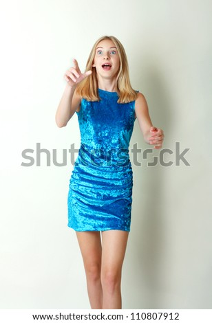 Portrait of an excited teen girl excited and surprised trying to catch something against white background - stock photo