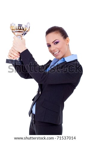 Portrait of an excited young business woman winning a trophy against white background - stock photo
