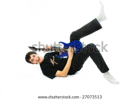 portrait of an excited young man playing the guitar on the floor, isolated against white background - stock photo