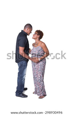 Portrait of an expecting African American couple looking at each other and holding hands isolated on white
