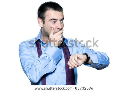 Portrait of an expressive businessman late for work, looking at his watch on isolated white background - stock photo