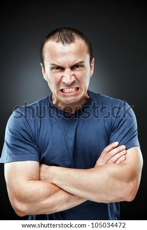 Portrait of an extremely angry young man - stock photo
