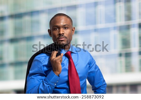 Portrait of an handsome businessman holding his jacket on the shoulder - stock photo