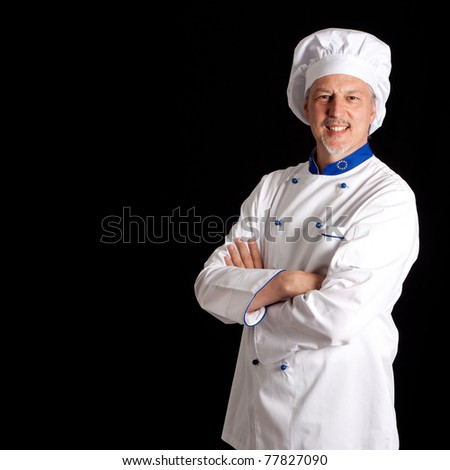 Portrait of an handsome chef. Dark copyspace. - stock photo