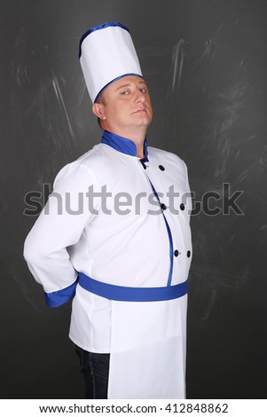Portrait of an handsome chef wearing workwear - stock photo