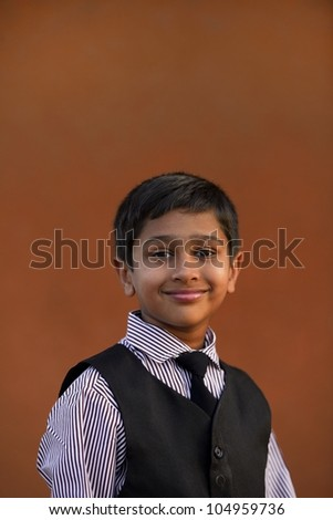 Portrait of an handsome child executive smiling - stock photo