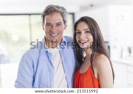 portrait of an handsome couple at home - stock photo