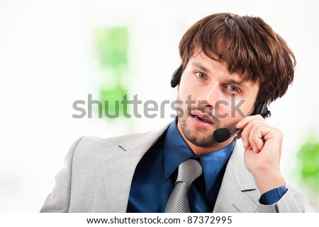Portrait of an handsome customer representative at work - stock photo