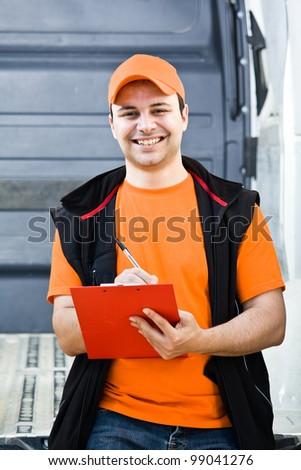 Portrait of an handsome deliverer - stock photo