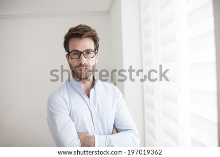 Portrait of an handsome man arm crossed - stock photo