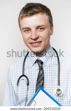 Portrait of an handsome young doctor - stock photo