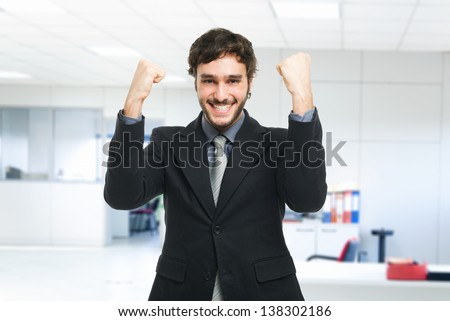 Portrait of an happy businessman - stock photo