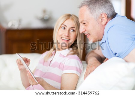 Portrait of an happy couple using a tablet - stock photo