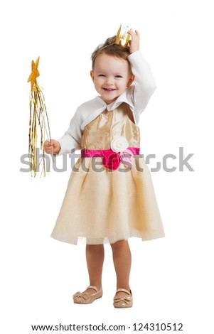 portrait of an happy smiling and laughing little blonde girl with a crown wearing a princess costume and holding a wand isolated on white background