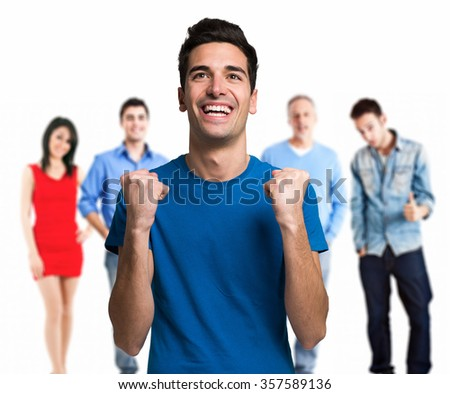 Portrait of an happy young man in front of a group of people - stock photo