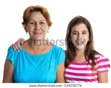 Portrait of an hispanic grandmother and granddaughter together isolated on white