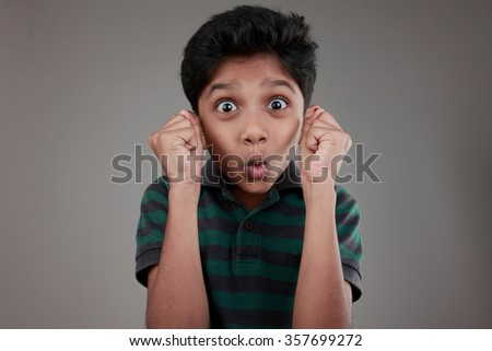 Portrait of an Indian boy with a surprise expression - stock photo