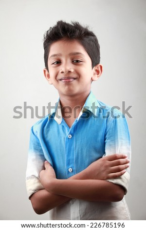 Portrait of an Indian boy with hands tied together - stock photo