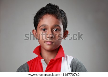 Portrait of an Indian boy with twisted smile