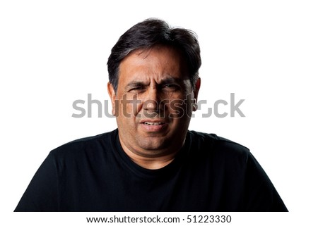 Portrait of an Indian man, isolated studio shot - stock photo