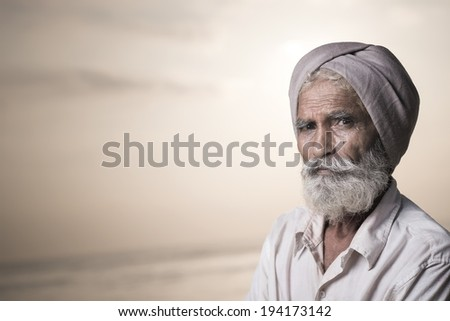 Portrait of an Indian old man - stock photo
