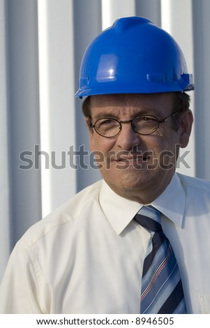 Portrait of an industrial surveyor on location - stock photo