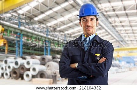 Portrait of an industrial worker in a factory - stock photo