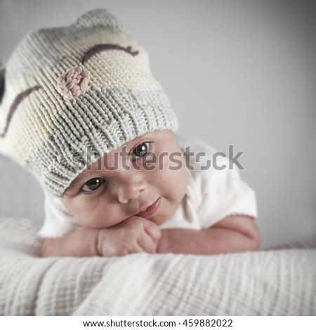 Portrait of an infant girl wearing a winter knit hat
