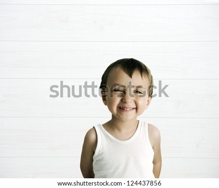 Portrait of an innocent kid  giving you a cute smile with large white copy space - stock photo