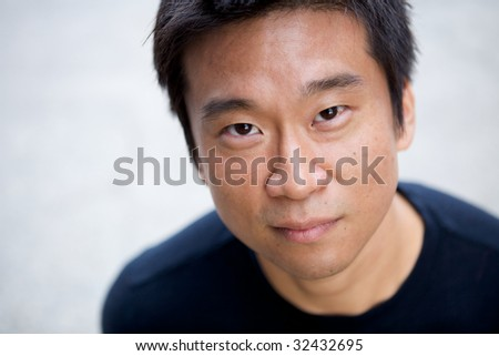 Portrait of an interesting asian man with an honest face - stock photo