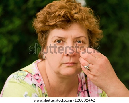 Portrait of an middle-aged woman deep in thought - stock photo