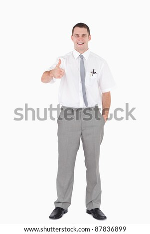 Portrait of an office worker with the thumb up against a white background