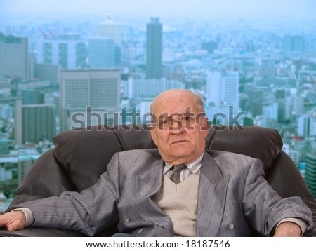 Portrait of an old businessman in front of the office window in a big city. - stock photo