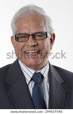 Portrait of an old businessman smiling - stock photo