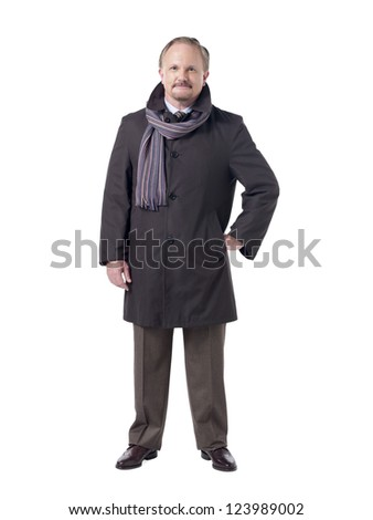 Portrait of an old businessman with scarf around his neck standing on a white surface - stock photo