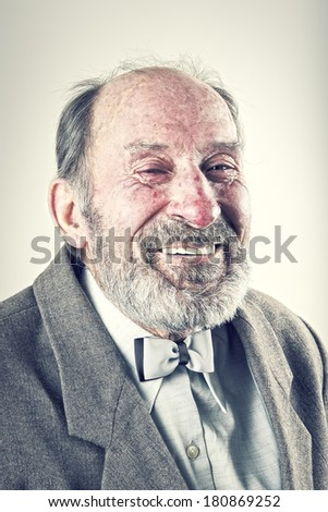 Portrait of an old man in a suit with a bow tie