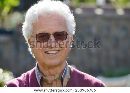 Portrait of an old man in the garden - stock photo