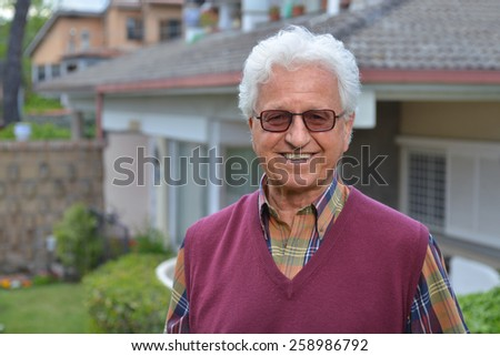 Portrait of an old man in the garden